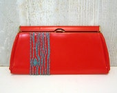 red clutch with turquoise tree
