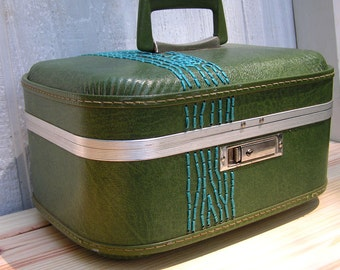 train case with turquoise tree