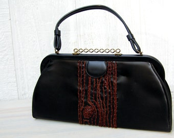 black purse with brown tree