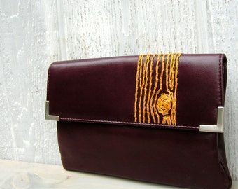 gold woodgrain embroidered clutch