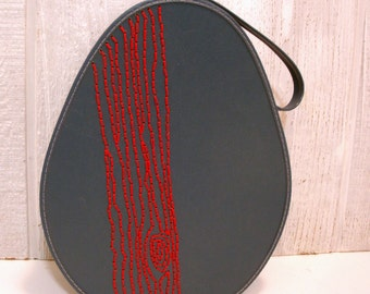 travel case with red tree