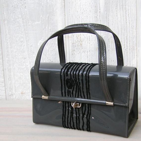 gray handbag with black tree