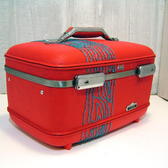 red train case with turquoise tree