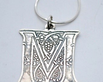 Silver letter pendant