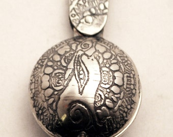 Sterling Silver locket  - moongazing hare - swivel design - etched locket