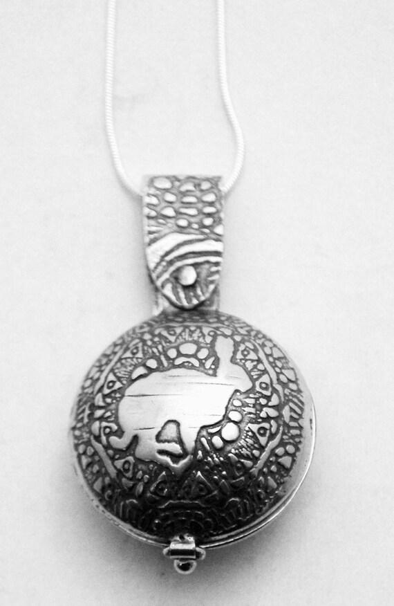Sterling Silver hare locket - swivel design - running hare - etched locket