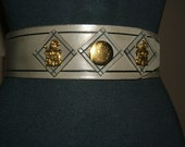 1950s Wide Gray Cinch Belt with Brass tone Accents. Harlequin and Royal Crest Design by Jonathan. S M Adjustable.