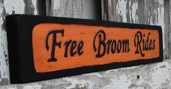 Free Broom Rides sign BOGO