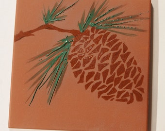 Pottery Tile Trivet with Pincone Decoration