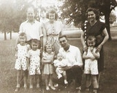 1950s Vintage Photo Family In Striped And Polka Dot Clothing