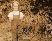 Vintage Snapshot Photo Little Girl In The Garden Wearing Checkered Overalls With Bib