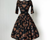 vintage 1950's dress ...fabulous JONATHAN LOGAN black and copper polished cotton mayan print full skirt pin-up cocktail party dress