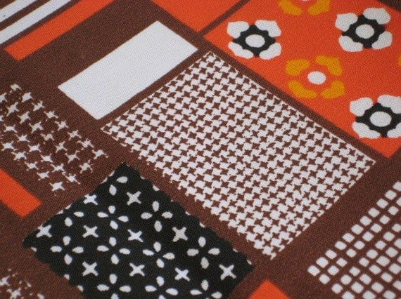 One yard plus of vintage early 70s block pattern fabric by Klopman Mills in brown, black, white, orange.