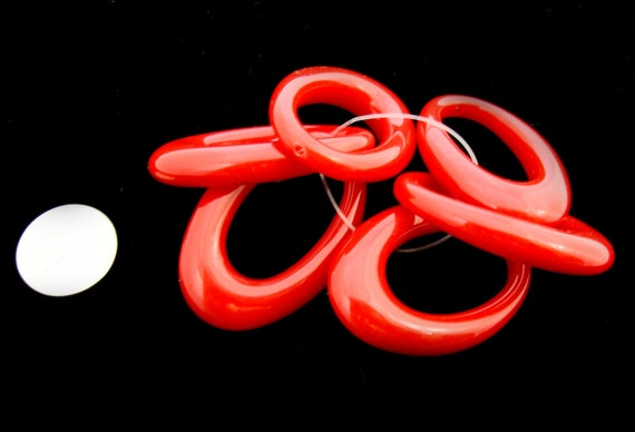 Fantastic red vintage Lucite and plastic ovals. Rings, loops, drops ovals... BONUS BEADS with every purchase.