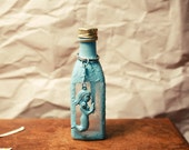 the messenger and the bottle - in aqua