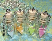 Origami Crane in tiny bottle - NEW patterns.  Available in blue, green, orange or pink.