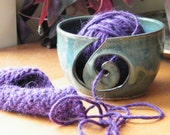 Blue yarn bowl with spiral cut-out and double dip rim