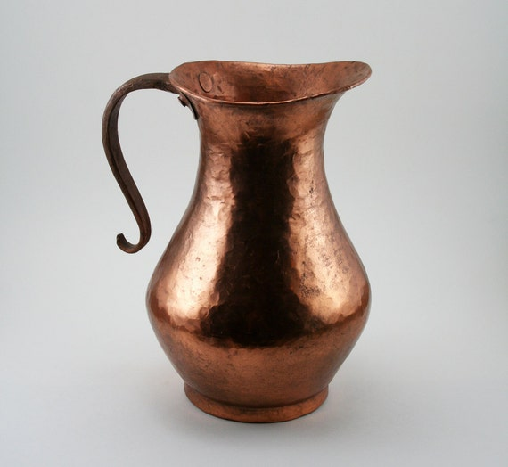 Copper Pitcher with Hammered finish, and gracefully curved handle