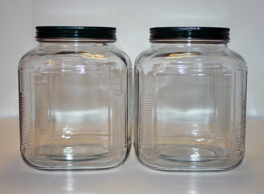 matching pair of large glass jars with green metal lids. Black Bedroom Furniture Sets. Home Design Ideas