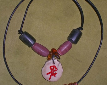Deer antler pendant with hand made soapstone pipe stone beads necklace