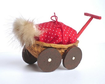 SALE- Walnut carriage with baby- Home decor ( Red duvet\/ comforter)