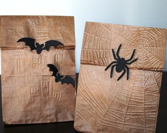 halloween haunted house with bats or spider and spider web treat bags