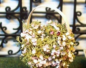 miniature basket , pink and white flowers