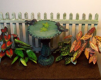 miniature birdbath, fence and caladium