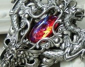 The Dread Lord Silver handmade necklace featuring silver dragon stampings and dragons breath glass opal