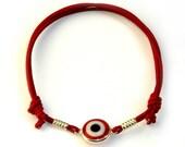 Red Evil Eye Bracelet from TOOSIS.ETSY.COM