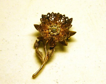 Floral with rhinestone center vintage brooch