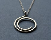 Half-Spiral Sterling Silver Necklace. Sleek, contemporary design for everyday wear.