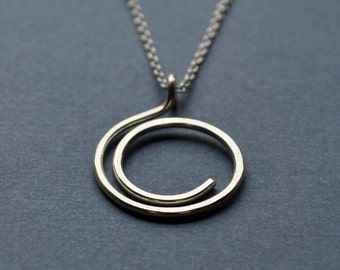 Half-Spiral Sterling Silver Necklace. Sleek, contemporary design for everyday wear.