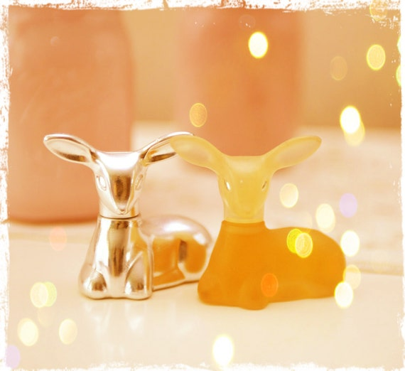 Two Avon deer perfume bottles one silver one amber free shipping US
