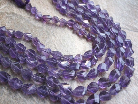 Amethyst Top drilled Twisted Teardrops Full Strand