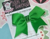 Solid Kelly Green Mini Tylie Bow on a NO SLIP velvet lined clip