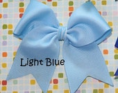 Solid Light Blue Tylie Bow on a NO SLIP velvet lined clip