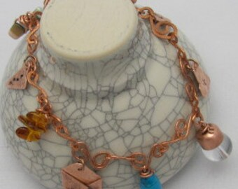 Copper Charm Bracelet ,Circle of Life, Squiggles, twirls,  7 handmade charms.