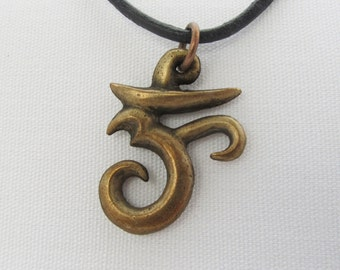 Om in aged bronze