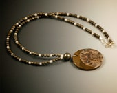 Ammonite Fossil Pendant with Pyrite and Moonstone