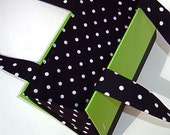 The Shepherd in Preppy Green with black and white polka dot fabric