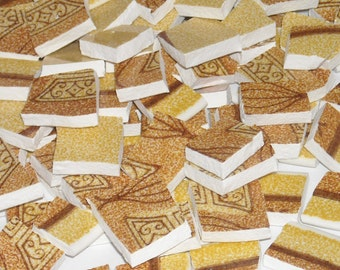 Vintage Burnt orange, brown, and yellow hand cut mosaic tiles from plates