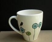 ceramic fun colorful black bird coffee mug on blue stripe flowers ,  gift for gardener, bird lover, hostess, friend