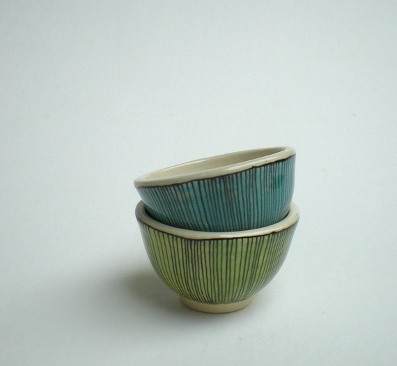 two small cups in blue and green