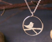 Modern sterling silver pendant with bird and branch