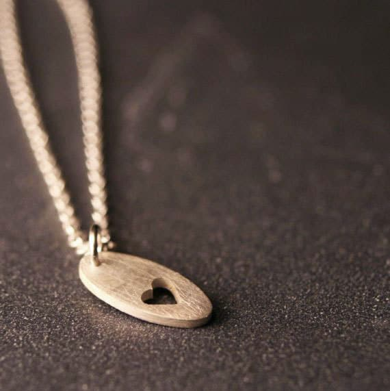 Sterling silver pierced heart tiny charm necklace