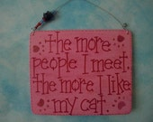 the more people i meet, the more i like my cat - sign in pink