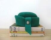 vintage 60s emerald green pillbox hat, rhinestone brooch, peachbloom velour