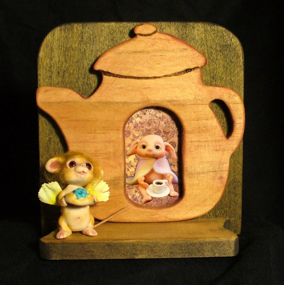 Wood teapot with mouse shelf display