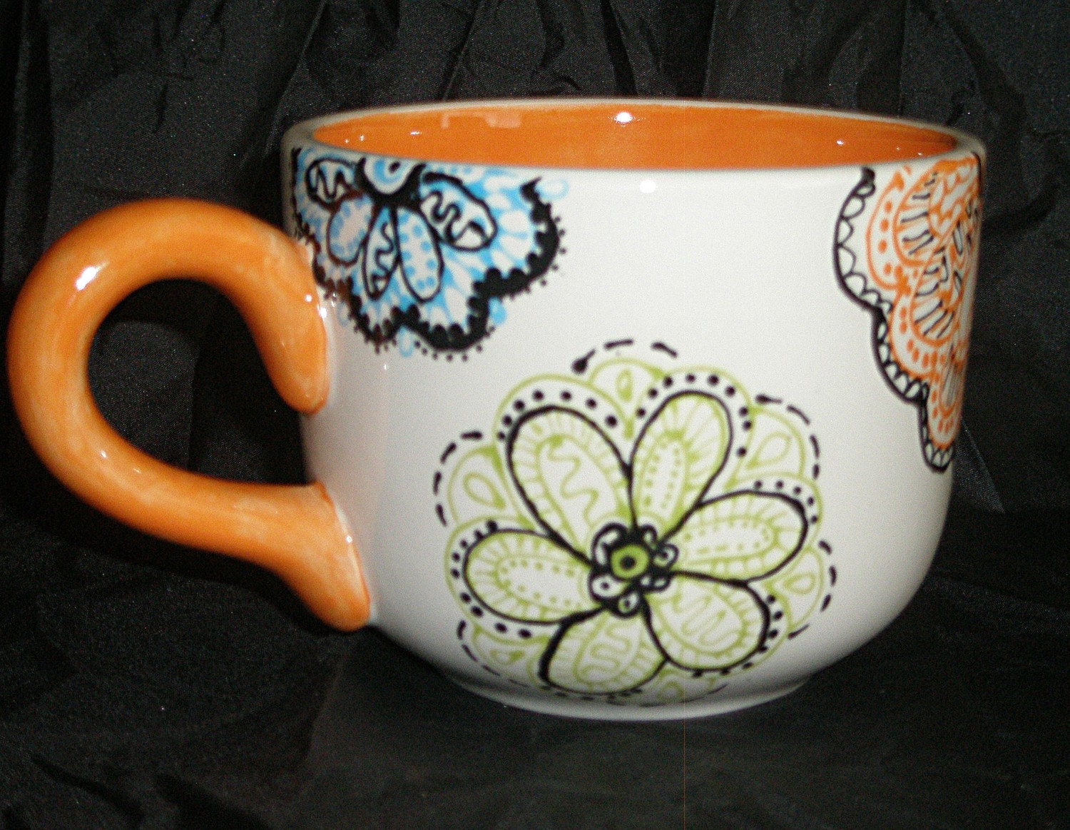 Bright orange hand painted floral latte mug for How to paint ceramic mugs at home